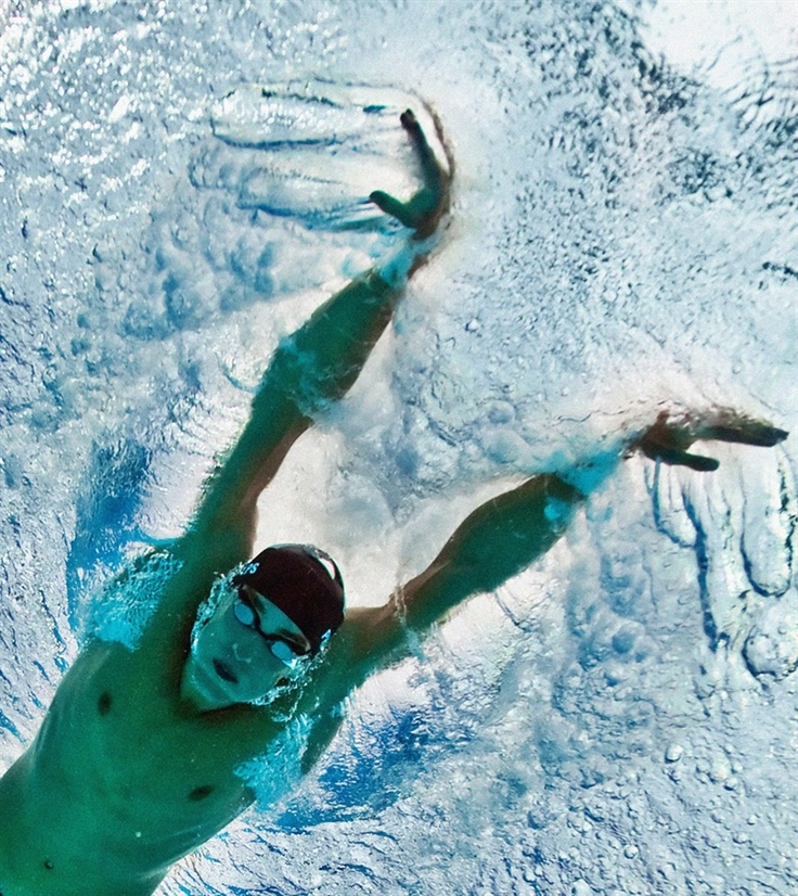 This underwater photograph shows U.S. swimmer Michael Phelps competing during the men's 200m butterfly swimming semifinal at the National Aquatics Center in the 2008 Beijing Olympic Games on August 12, 2008.
