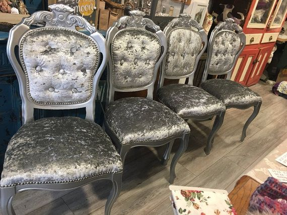 These decorative and ornate chairs have been given a new lease of life and will look fabulous around your dining table or perhaps in a bedroom. They have been painted by hand in a wonderful silver finish. Finally we reupholster the chair with a quality crushed velvet fabric to create a beautiful finish. We can also upholster these chairs in fabric of your choosing - go as crazy or as calm as you like.  Chairs are available individually, as pairs or as sets. The chairs shown on the pictures…