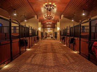 Planned with the horse in mind at every turn this magnificent equestrian facility was constructed with the highest quality of materials and built like a fortress. Absolutely no detail was overlooked throughout the entire property. The 20-stall barn jump arena grass Grand Prix field four paddocks hot walker and industrial generator are a few of the top amenities to be found on-site. And with an owner's apartment,  manager's apartment ...