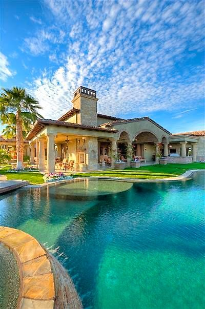 absolutely splendid luxury mansion exterior with swimming pool