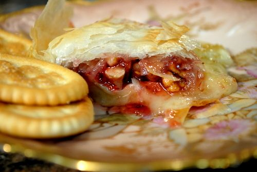 Baked Brie with Raspberry Jam and Sauteed Pecans. (The easiest yet most impressive, delicious, and decadent appetizer you'll ever make.)