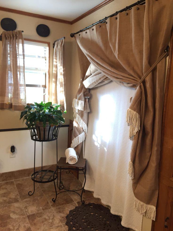 Burlap bath with a fringed burlap shower curtain, pearl & lace trim on the burlap swing arm window treatment.