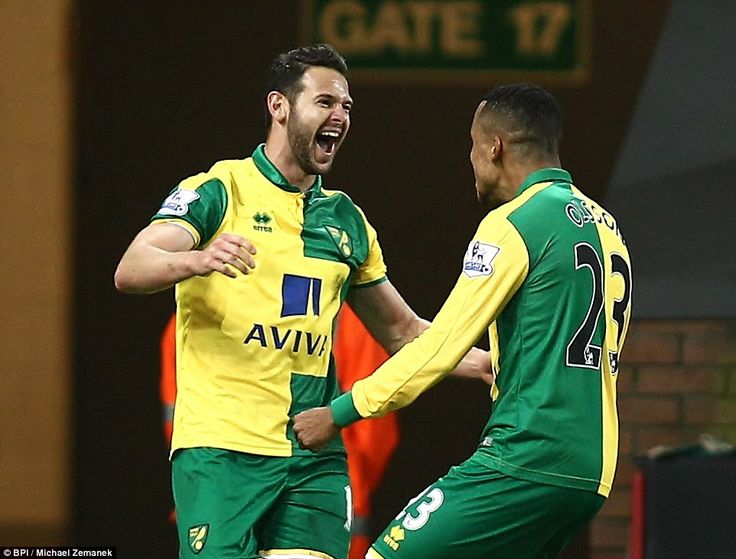 Jarvis celebrates with Norwich City team-mate Martin Olsson during their Capital One Cup clash against West Brom at Carrow Road