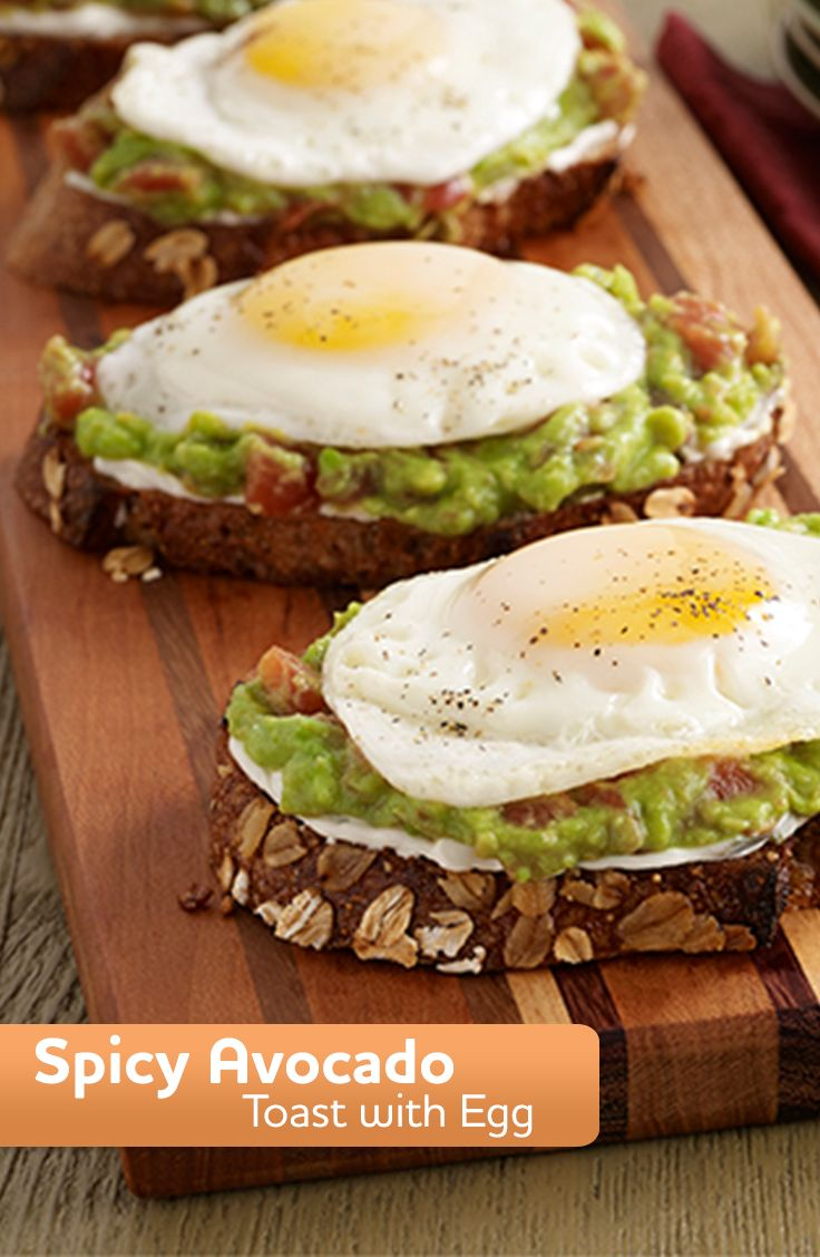A vegetarian toast recipe of cream cheese on whole grain bread, topped with mashed avocado and zesty tomatoes with an egg. An easy Meatless Monday dinner idea.