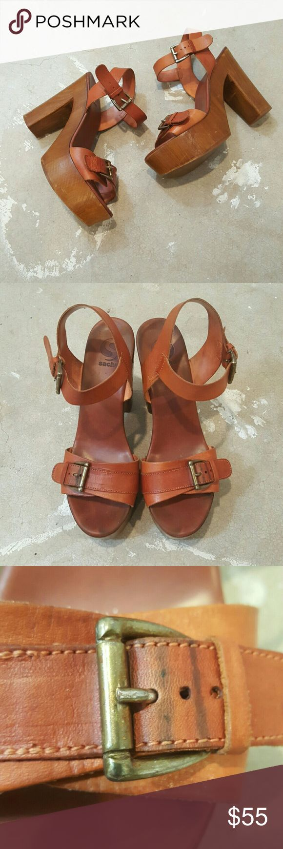 """Sacha Rust Brown Platform Sandals I am selling my all time favorite, most comfortable pair of Sacha platform, sandals. These are so cool in a reddish, rust, brown color which is what immediately drew me to them, once I put them on I was hooked.  They do have signs of wear, see pics, however they cool """"vibe"""" only get better with age.  60's revival in the best way!!  Pair them with flair jeans and you are a trendsetting arrow, reaching back in time and pulling out current must haves!!  Size…"""