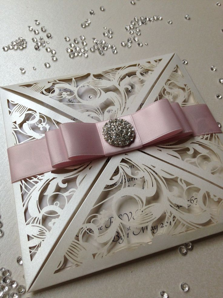Ivory pearl laser cut wedding invitation with