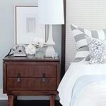 bedrooms - brown gray blue white lamp wood nightstand cream upholstered wood headboard blue white bedding gray white striped stripe pillows gray blue walls bedroom
