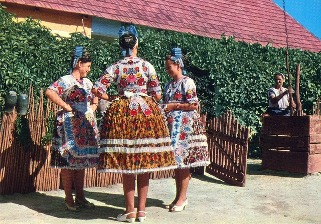 Full skirted, beautifully floral patterned traditional Hungarian folk costumes.