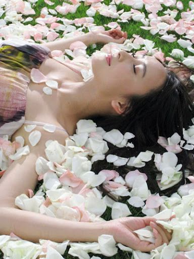 Relaxing and dreaming...on rose petals
