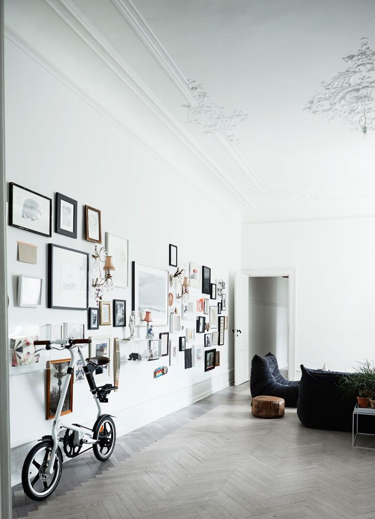 creative gallery wall in a spacious Copenhagen apartment