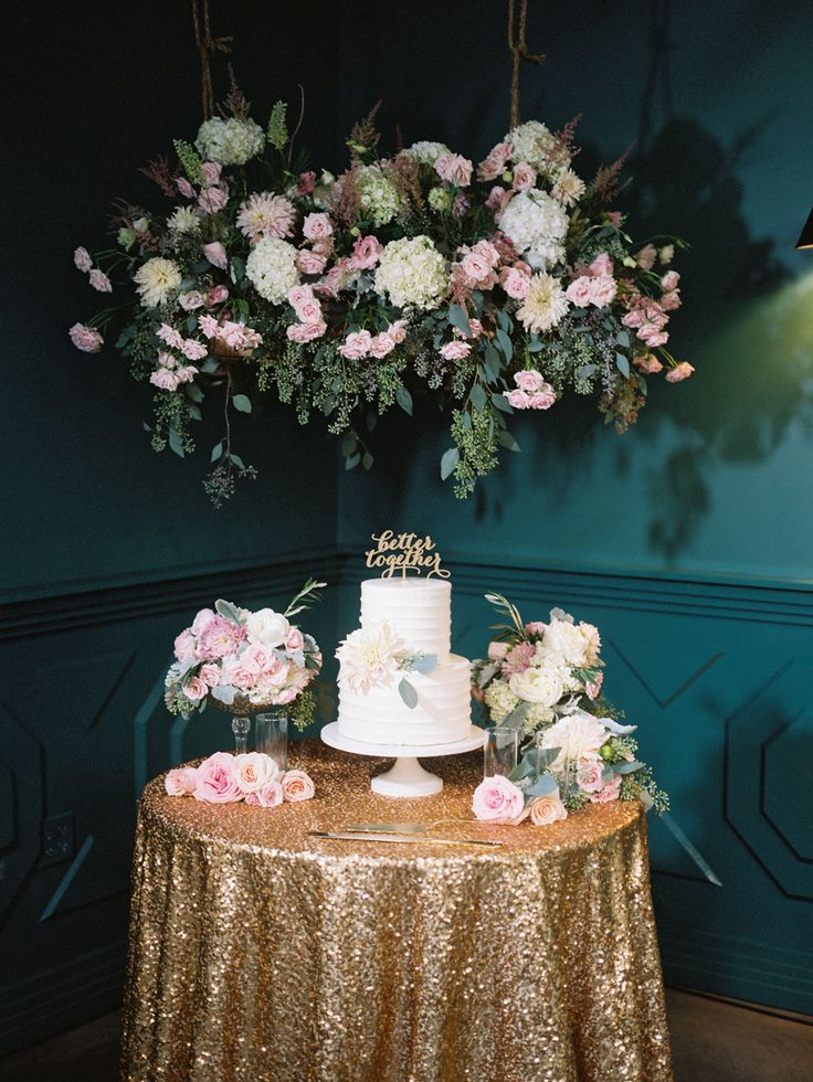 18 best whimsical fig house wedding images on pinterest wedding hanging floral centerpiece above wedding cake ccl weddings events fig house los angeles photography by junglespirit