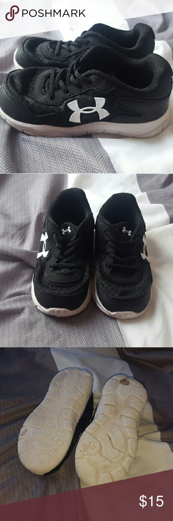 Under Armour tennis shoes Used classic black and white tennis shoes.  Shows normal signs of wear,  especially on the bottoms of the shoes. Other than that they are in very good condition.  8c. For either toddler boy or girl Under Armour Shoes