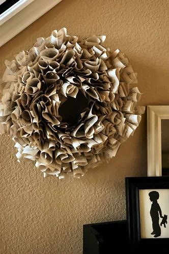Old pages from a vintage book are individually rolled and attached to a ring to create this vintage paper wreath. This wreath could easily decorate a space year-round.