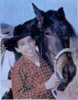 What a great website. It has photos of all the famous horses used in TV and in movies. This is a photo of Johnny Crawford and his horse Blueboy.