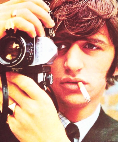 Ringo Starr. Always with a camera or a cigarette, or both.