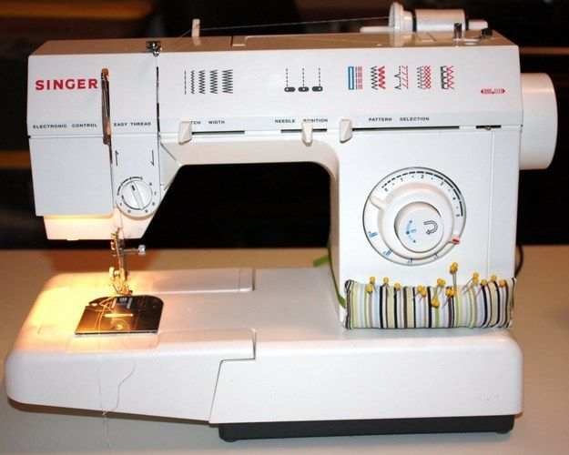 You'll never have to search for a pin again if your pincushion is attached to your sewing machine. | Community Post: 45 Organization Hacks To Transform Your Craft Room