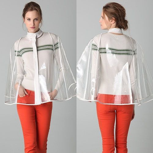 Classy clear plastic poncho with white trim worn with burnt orange pants and white long sleeved top with stripes.. DIY the look yourself: http://mjtrends.com/pins.php?name=clear-vinyl-material-for-poncho_1