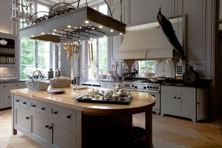 Gorgeous French Kitchen with Hanging Rack and Amazing Windows...and a peacock