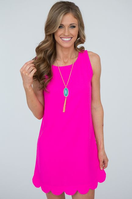Turn heads in this classy and fun woven sleevless shift dress with scalloped hem. Key hole button closure on back neckline. 100% polyester. Free Shipping on orders over $50.
