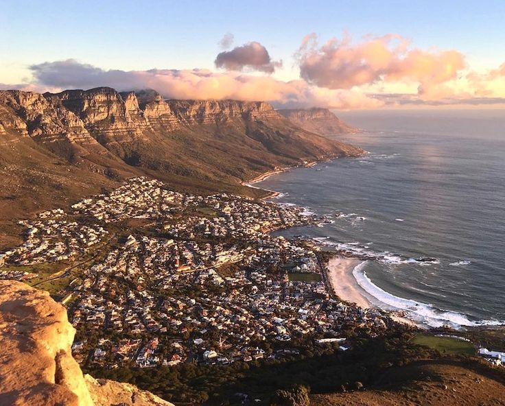 The late afternoon sun glitters over Camps Bay a breath-taking pause for the city of Cape Town. Photo: @elise_queru #campsbay #CapeTown #views #sunset #mountains #citylife #SouthAfrica #naturalbeauty #ilovecapetown #capetownmag