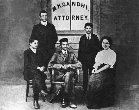 Gandhi (center) with his secretary, Miss Sonia Schlesin, and his colleague Mr. Polak in front of his Law Office, Johannesburg, South Africa, 1905.