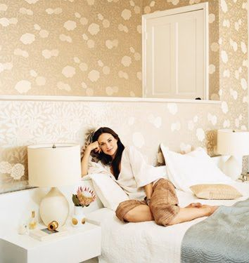 Claire Forlani in her bedroom, featured in domino magazine, with Osborne & Litttle's Asuka wallpaper