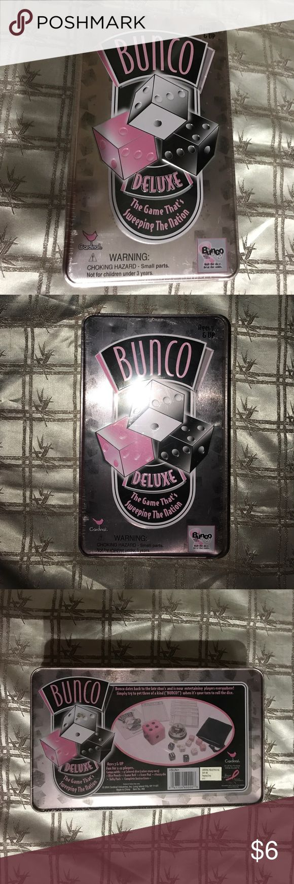 Bunco Deluxe Game NWT. Bunco dates back to the late 1800s and is now entertaining players everywhere. Simply try to get three of a kind, when its your turn to roll the dice. Ages 7 and up. Fun for 2 to 12 players. Everything you need is in this decorative tin: dice in a handy pouch, score sheets, bell and a large fuzzy die. Cardinal Other