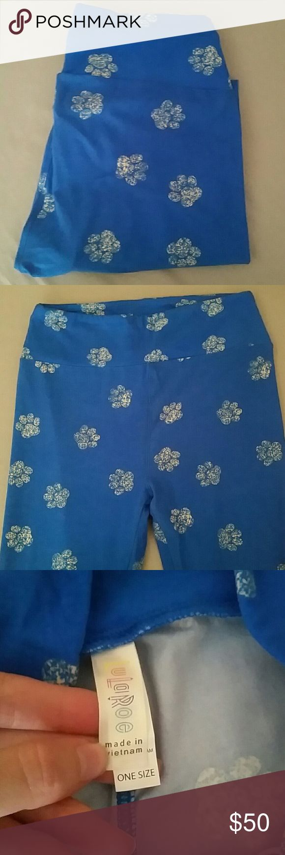 Lularoe OS Pawprints HTF Super hard to find Lularoe OS Pawprints. The last shot is a crotch shot. They have been worn and washed once but they are in excellent condition. LuLaRoe Pants Leggings
