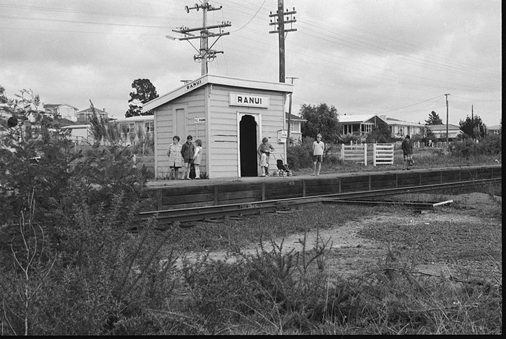 Ranui Railway Station c1972. Pooks Road in background. It opened in 1925. Built close to Metcalfe Rd where H. Metcalfe had a farm and orchard named 'Ranui'. http://paperspast.natlib.govt.nz/cgi-bin/paperspast?a=d&cl=search&d=AS19260512.2.25&srpos=1&e=-10-1915---1927--10--1----0ranui+station+railway--