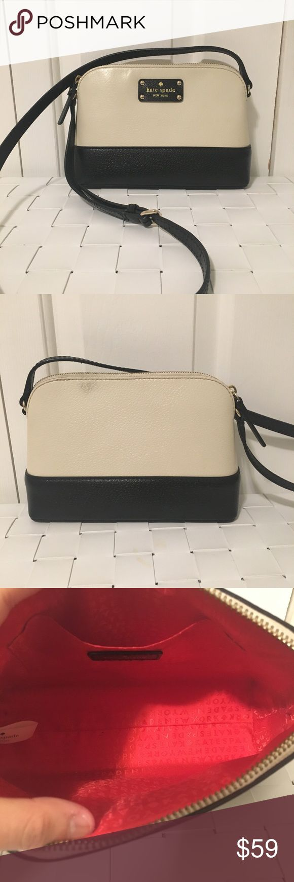 Kate spade Wellesley hanna Crossbody bag Black and cream Crossbody bag In good condition  Minor stain on back of bag Slight stains on the interior  Beautiful Crossbody bag Slight color fading beside zipper pull on top kate spade Bags Crossbody Bags