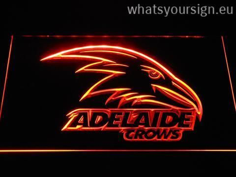 Adelaide Crows - LED neon sign made of the best-quality clear plastic and glowing colorful LED lighting. The neon sign looks exactly the same from every angle thanks to the carving with the modern 3D laser engraving process. This LED neon sign is a great gift idea! The neon is provided with a metal chain for displaying. Available in 3 sizes in following colours: White, Yellow, Blue, Orange, Green, Red and Purple!