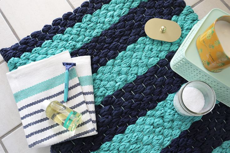 Weave a bath mat from fabric yarn with this easy tutorial at www.aBeautifulMess.com, but why not use this for an ordinary rug?