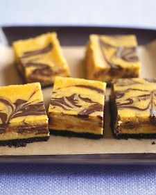 To create swirls, drag the blade of a paring knife through the chocolate and pumpkin mixtures several times to make a marbled pattern.