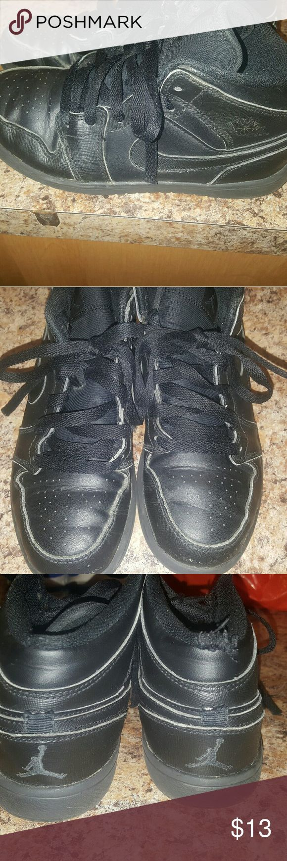 Jordan 1 Shoes Jordan 1 black shoes size 2.5Y Lil scratch at very tip front when he walked rub the floor some. No string end on the shoe strings at the end of strings. Look on picture 1 and 2 no ends on shoe strings . Jordan Shoes Sneakers