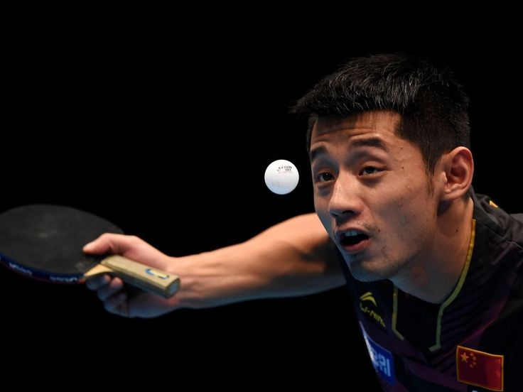Zhang Jike of China serves a ball to China's Ma Long during the men's singles semifinal match of the 2015 ITTF World Tour Grand Finals in Odivelas, Portugal.  Francisco Leong, AFP/Getty Images