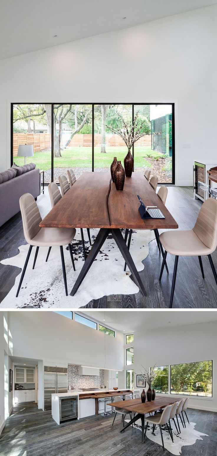 the interior of this modern house has a dining area with views of the backyard