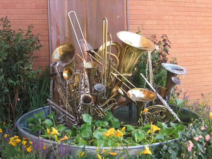 Sean has been dying to have a fountain or pond for years so I thought one would be a good focal point in the shade garden I am planning for our small, North facing entryway.  We have a garage full of unplayable instruments, maybe he could build something similar to this!