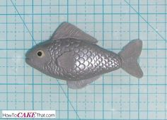 Photo tutorial on how to make realistic fish scales the easy way! Learn how to transform a simple everyday item into the perfect tool for creating scales in fondant, gum paste or modeling chocolate :)