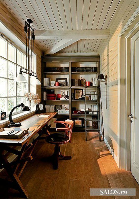 This home office is very unique on the decoration as it breathes a more rustic style with the wooden furniture. It also has plenty of storage whith a big shelves-wall and the big window gives it all the lightning that it needs. It's a confortable home office perfect for your country cottage.
