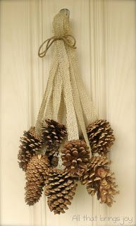 Pincones for the door.  Just need Burlap cut into strips Twine Cinnamon pinecones from Hobby Lobby Big jingle bells from Hobby Lobby Hot glue gun