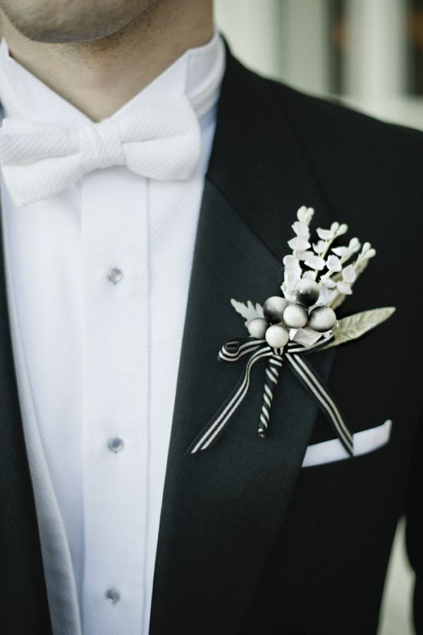 Awesome black & white tuxedo vest and bow tie - very sleek. The boutonniere is a great touch for a Holiday season wedding!