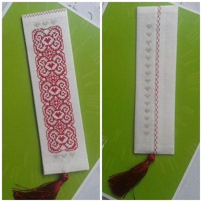 Cross stitch bookmark with a tassel.