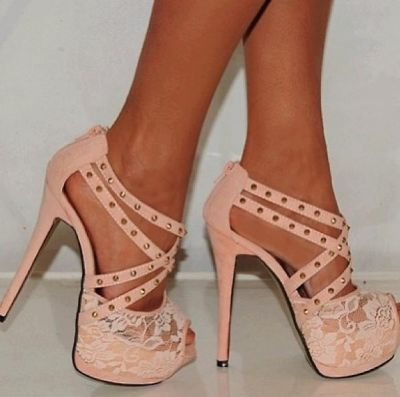 Sexy heels, with a dash of lace in the front. I wish I could wear these and not look like a giant!