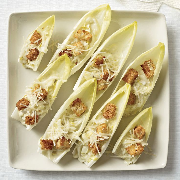 Salads usually require forks, but Grace Parisi transforms a classic Caesar into a clever finger food. She tosses chopped endives with a lemony dressin...