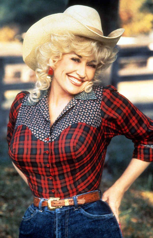 These plaid sleeves are a nod to Dolly's humble country roots. | 19 Of Dolly Parton's Most Fanciful Sleeves