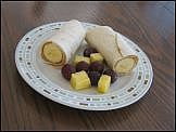 Breakfast Tortillas: spread PB on a tortilla, roll it around a banana.  Maybe add some yogurt as a dip? - Bridget loves bananas, PB, and tortillas but for some reason if you put them together, she won't touch it.  :(