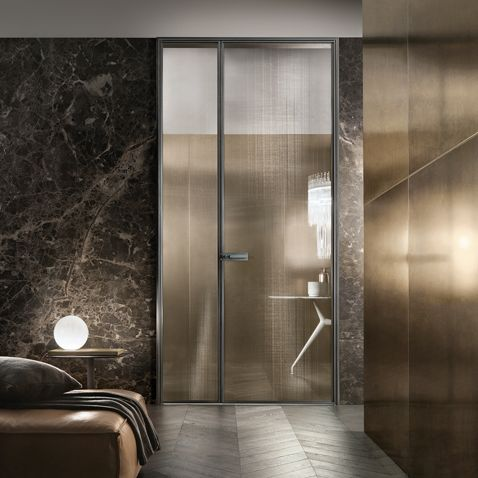 """Spin"" Door by Rimadesio. Brushed lead structure and bronze net glass."