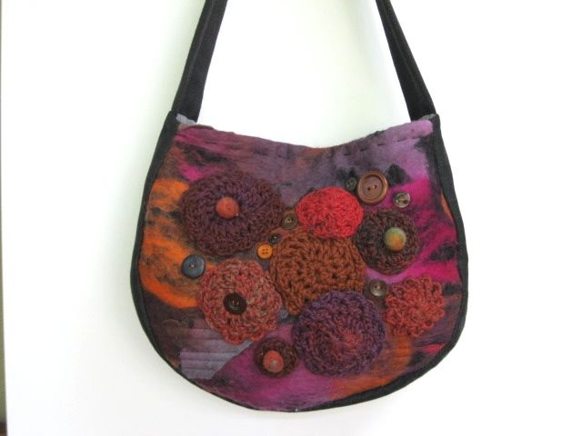 Felted front panel bag. Black fabric used for side panel, handle and back panel. Embellished with crotchet motifs, buttons and felted balls. See my store at www.madeit.com.au/HookandBobbin