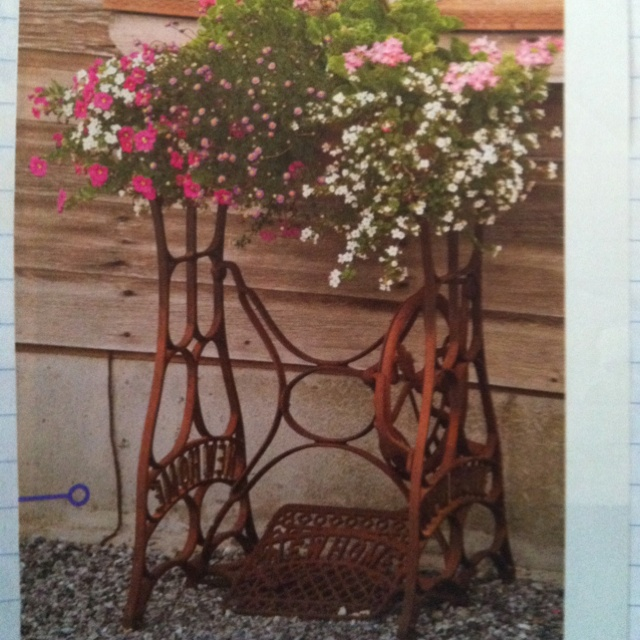 Old sewing machine planter - also a good idea for a potting bench base.