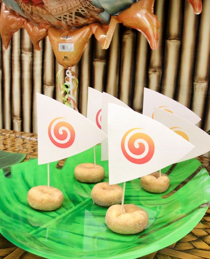 This easy Moana party food idea is guaranteed to be a hit with your guests. Use cocktail sticks and our free printable sails to transform mini doughnuts into Moana's boat!